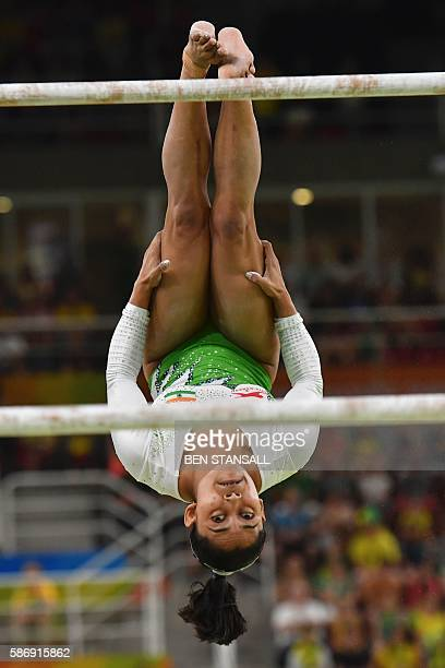 India's Dipa Karmakar competes in the qualifying for the women's Uneven Bars event of the Artistic Gymnastics at the Olympic Arena during the Rio...