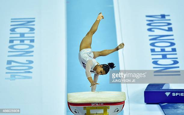 India's Dipa Karmakar performs in the women's vault final of the artistic gymnastics event during the 2014 Asian Games at the Namdong Gymnasium in...