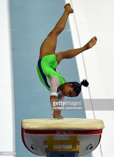 India's Dipa Karmakar performs on the vault at the Namdong Gymnasium during the artistic gymnastics women's qualification and team final of the 2014...
