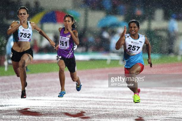 India's Dutee Chand competes in women's 100m run to place third during the second day of the 22nd Asian Athletics Championships at Kalinga Stadium in...
