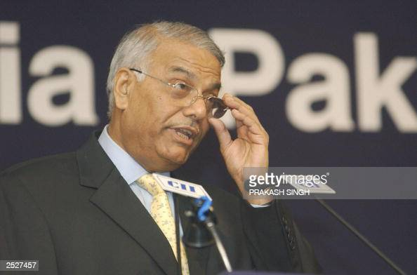 India's External Affairs Minister Yashwant Sinha adjusts his glasses as he speaks during the inauguration of 'IndiaPakistan CEO's Business Forum'...