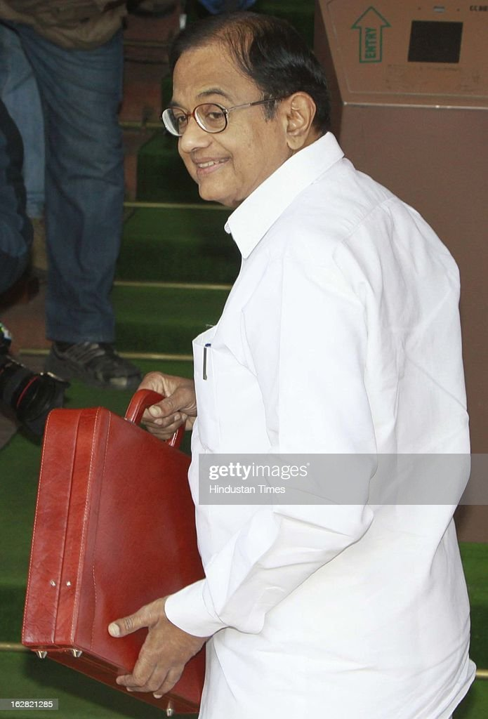 India's Finance Minister P. Chidambaram arrives at the parliament to present the 2013-14 Union budget on February 28, 2013 in New Delhi, India. Chidambaram will present one of the most highly anticipated budgets of recent years, a blueprint for austerity that forms the centre piece of India's efforts to stave off a ratings downgrade. Investors will watch closely to see whether he will fulfill his promise of fiscal prudence.