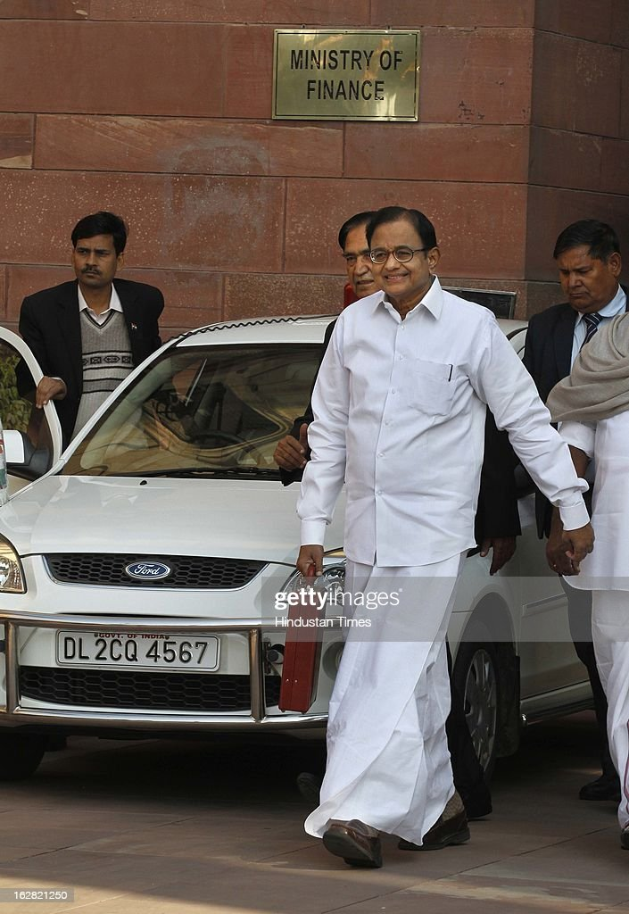 India's Finance Minister P. Chidambaram with his cabinet colleagues leaves the Finance Ministry to present the 2013-14 Union Budget on February 28, 2013 in New Delhi, India. Chidambaram will present one of the most highly anticipated budgets of recent years, a blueprint for austerity that forms the centre piece of India's efforts to stave off a ratings downgrade. Investors will watch closely to see whether he will fulfill his promise of fiscal prudence.