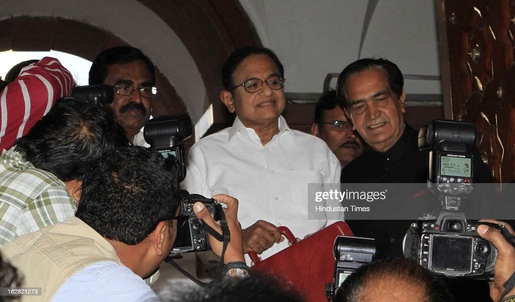 India's Finance Minister P. Chidambaram (C) with State Finance Minister Namo Narain Meena (R) and Union Minister of State Finance S.S. Palanimanickam (L) at the parliament to present the 2013-14 Union Budget on February 28, 2013 in New Delhi, India. Chidambaram will present one of the most highly anticipated budgets of recent years, a blueprint for austerity that forms the centre piece of India's efforts to stave off a ratings downgrade. Investors will watch closely to see whether he will fulfill his promise of fiscal prudence.