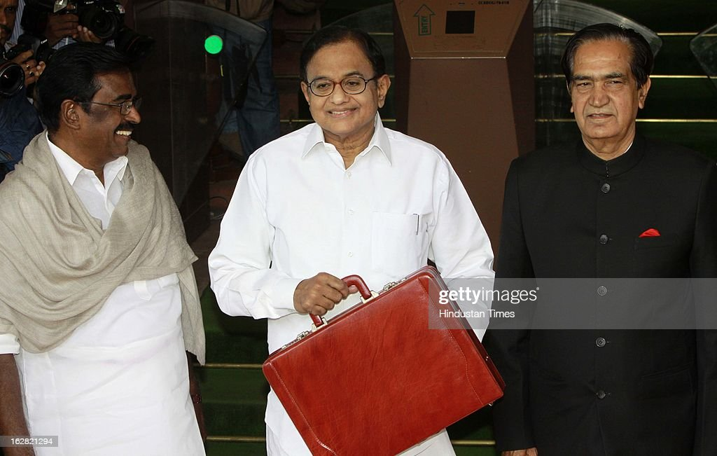 India's Finance Minister P. Chidambaram (C) with State Finance Minister Namo Narain Meena (R), Union Minister of State Finance S.S. Palanimanickam (L) at the parliament to present the 2013-14 Union budget on February 28, 2013 in New Delhi, India. Chidambaram will present one of the most highly anticipated budgets of recent years, a blueprint for austerity that forms the centre piece of India's efforts to stave off a ratings downgrade. Investors will watch closely to see whether he will fulfill his promise of fiscal prudence.