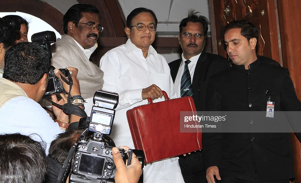 India's Finance Minister P. Chidambaram (C) with Union Minister of State Finance S.S. Palanimanickam (L) at the parliament to present the 2013-14 Union Budget on February 28, 2013 in New Delhi, India. Chidambaram will present one of the most highly anticipated budgets of recent years, a blueprint for austerity that forms the centre piece of India's efforts to stave off a ratings downgrade. Investors will watch closely to see whether he will fulfill his promise of fiscal prudence.