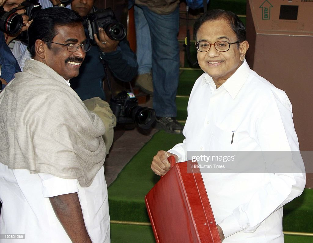 India's Finance Minister P. Chidambaram with Union Minister of State Finance S.S. Palanimanickam (L) at the parliament to present the 2013/14 union budget on February 28, 2013 in New Delhi, India. Chidambaram will present one of the most highly anticipated budgets of recent years, a blueprint for austerity that forms the centre piece of India's efforts to stave off a ratings downgrade. Investors will watch closely to see whether he will fulfill his promise of fiscal prudence.