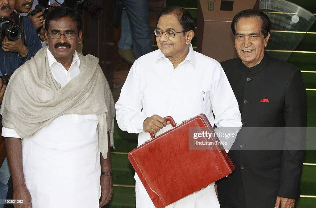 India's Finance Minister P. Chidambaram with Union Minister of State Finance S.S. Palanimanickam (L) and Union Minister of State FinanceS.S. Palanimanickam (L) at the parliament to present the 2013/14 union budget on February 28, 2013 in New Delhi, India. Chidambaram will present one of the most highly anticipated budgets of recent years, a blueprint for austerity that forms the centre piece of India's efforts to stave off a ratings downgrade. Investors will watch closely to see whether he will fulfill his promise of fiscal prudence.