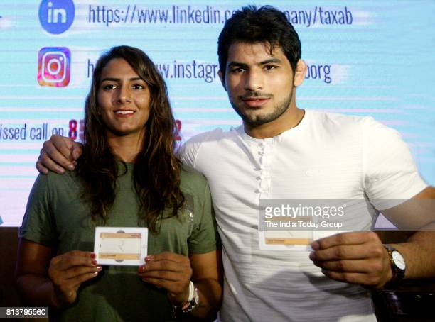 India's first Commonwealth Games wrestling gold medallist Geeta Phogat with her husband Pawan Kumar takes an oath not to have more than two children...
