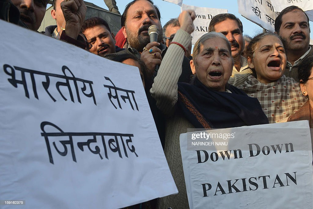 India's former Punjab state Minister for Social Security, Women and Child Welfare, Laxmi Kanta Chawla (C) and social workers hold placards as they protest against the Pakistani government against the killing of Indian soldiers Lance Naik Hemraj and Sudhakar Singh during a demonstration in Amritsar on January 9, 2013. India summoned Pakistan's envoy in New Delhi Wednesday to protest the killing of two soldiers in a border clash, but warned against any escalation, after apparent tit-for-tat skirmishes that have led to deaths on both sides. Two Indian soldiers died after a firefight erupted in disputed Kashmir on Tuesday as a patrol moving in fog discovered Pakistani troops about 500 metres (yards) inside Indian territory, according to the Indian army. AFP PHOTO/NARINDER NANU