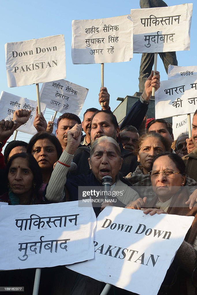 India's former Punjab state Minister for Social Security, Women and Child Welfare, Laxmi Kanta Chawla (C) and social workers hold placards as they protest against the Pakistani government against the killing of Indian soldiers Lance Naik Hemraj and Sudhakar Singh during a demonstration in Amritsar on January 9, 2013. India summoned Pakistan's envoy in New Delhi Wednesday to protest the killing of two soldiers in a border clash, but warned against any escalation, after apparent tit-for-tat skirmishes that have led to deaths on both sides. Two Indian soldiers died after a firefight erupted in disputed Kashmir on Tuesday as a patrol moving in fog discovered Pakistani troops about 500 metres (yards) inside Indian territory, according to the Indian army.