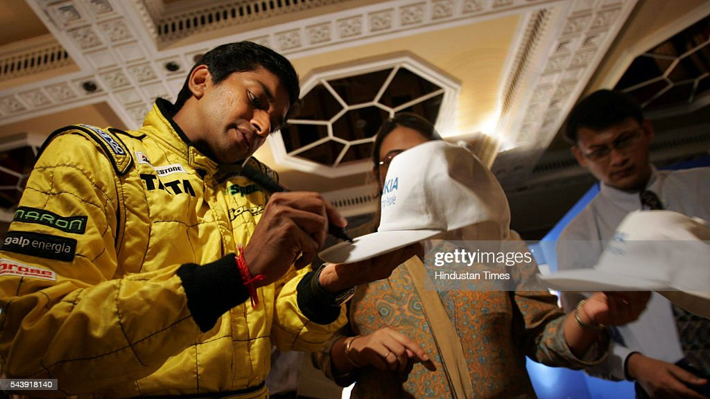 India's Formula One driver Narain Karthikeyan during the launch of a new range of mobile handsets at hotel Taj today. Indian telecom service provider Tata Teleservices has partnered with Nokia to announce new mobile handsets.
