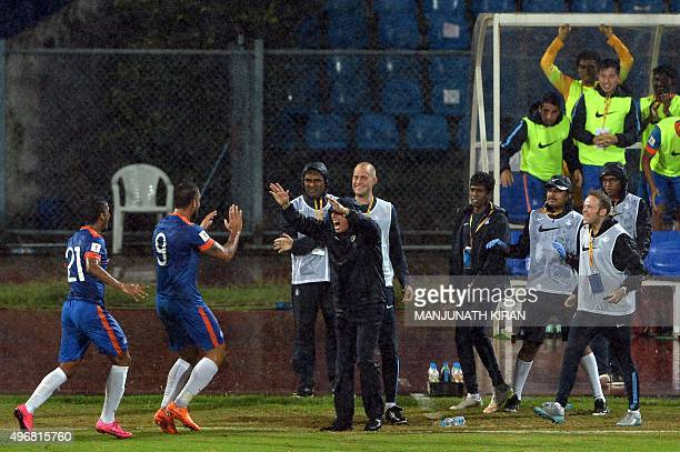 India's forward Robin Singh celebrates team's first goal with Indian coach Stephen Constantine during the the Asia Group D FIFA World Cup 2018...