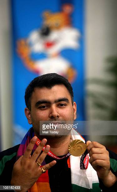 India's Gagan Narang celebrates after winning his fourth gold in the men's singles 50m rifle 3 position event of the Commonwealth Games at Dr K Singh...