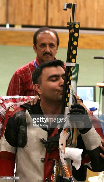 India's Gagan Narang shows his gold medal after winning the men's 10m individual air rifle event at the Commonwealth Games in New Delhi on Wednesday...