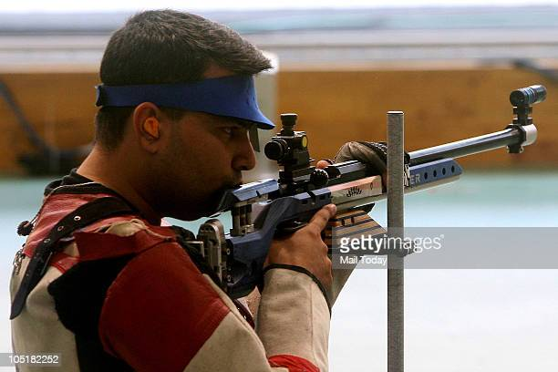 India's Gagan Narang takes aim in the men's singles 50m rifle 3 position event of the Commonwealth Games at Dr K Singh Shooting Range in New Delhi on...