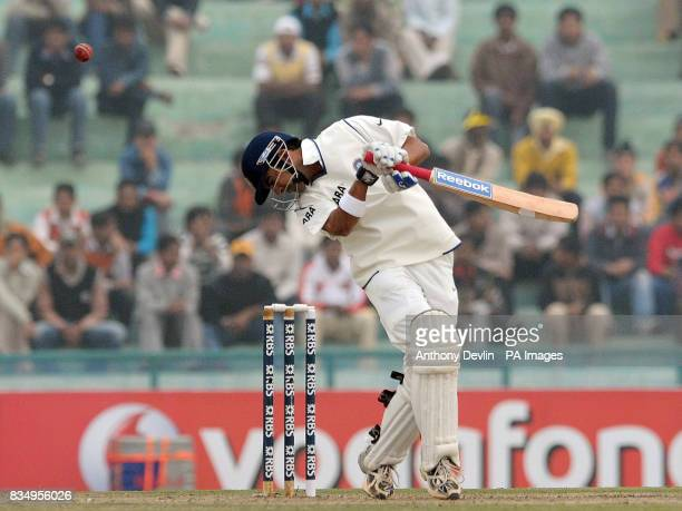 India's Gautam Gambhir avoids a bouncer from Andrew Flintoff during the second day of the second test at the Punjab Cricket Association Stadium...