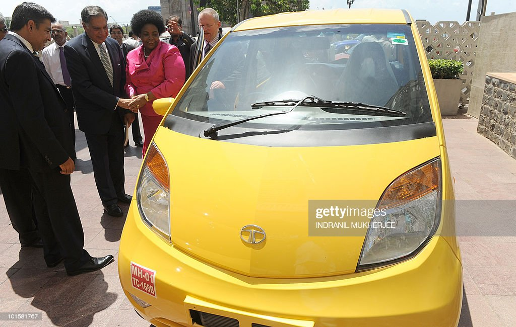 India's giant Tata group conglomerate Chairman Ratan Tata (2 L) shakes hands with South African International Relations Minister Maite Nkoane-Mashabane as she and her fellow colleague minister Robert Davies (R) inspect the world's cheapest car, the Tata Nano, in Mumbai on June 3, 2010. South African President Jacob Zuma, in India on his first state visit to Asia since taking office, met business leaders Thursday in Mumbai in a bid to boost trade ties. The 68-year-old president is accompanied by a 200-strong business delegation as well as key ministers, arrived in India on Wednesday.