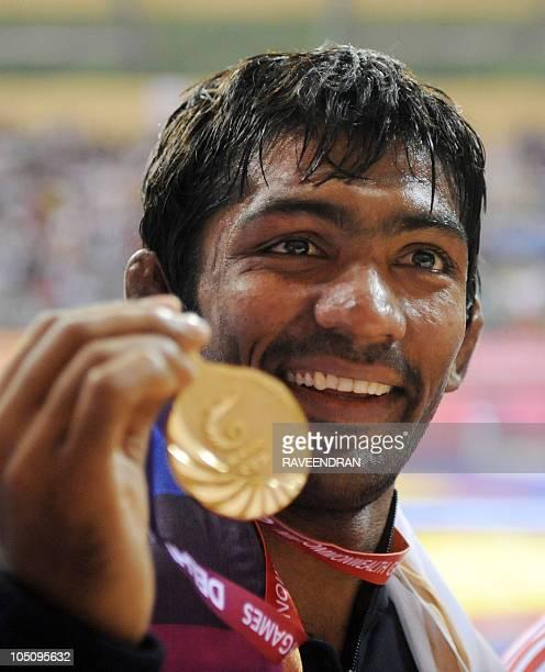 India's gold medalist Yogeshwar Dutt poses at the awards ceremony for 60kg men's freestye wrestling at the Commonwealth Games 2010 in New Delhi on...