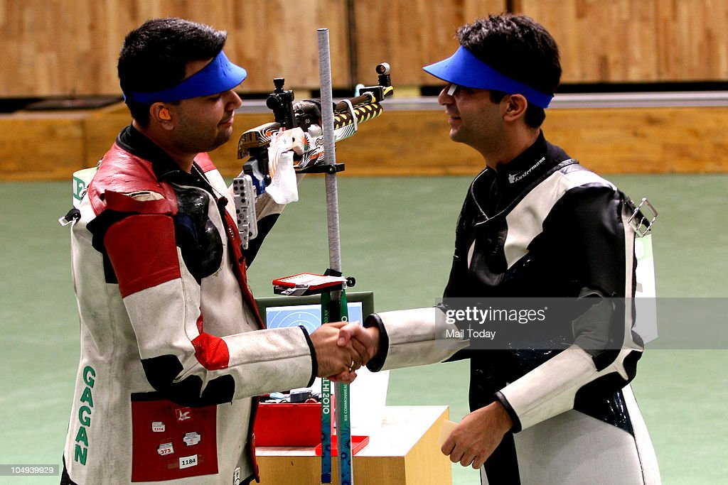 India's gold medallist shooter Gagan Narang is greeted by compatriot silver medallist Abhinav Bindra during the 10m air rifle event of Coomonwealth...