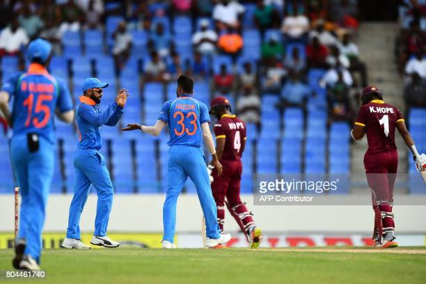 India's Hardik Pandya celebrates with captain Virat Kohli after dismissing West Indies' Kyle Hope during the third One Day International match...