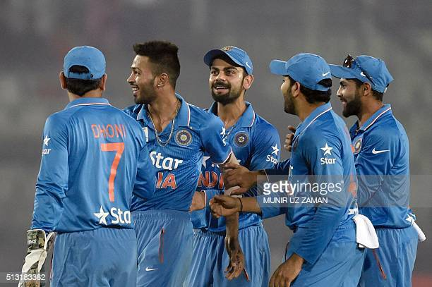 India's Hardik Pandya is congratulated by teammates after the dismissal of Sri Lanka's Tillakaratne Dilshan during the Asia Cup T20 cricket...