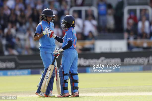 India's Harmanpreet Kaur celebrates reaching her half century during the ICC Women's World Cup cricket final between England and India at Lord's...