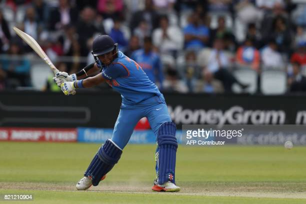 India's Harmanpreet Kaur hits a six during the ICC Women's World Cup cricket final between England and India at Lord's cricket ground in London on...