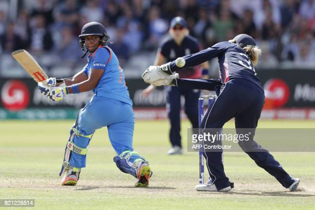 India's Harmanpreet Kaur plays a shot to reach her half century during the ICC Women's World Cup cricket final between England and India at Lord's...