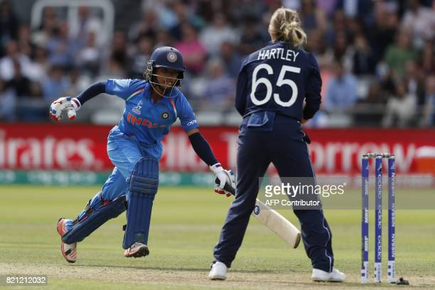 India's Harmanpreet Kaur runs back to her wicket during the ICC Women's World Cup cricket final between England and India at Lord's cricket ground in...