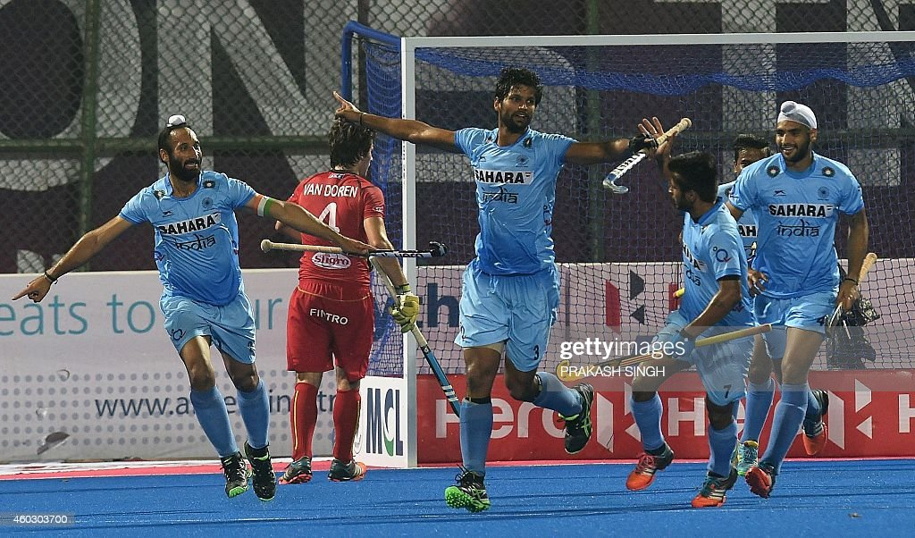 India's hockey captain Sardar Singh and teammate Rupinder Singh celebrate a goal against Belgium during their Hero Hockey Champions Trophy 2014...