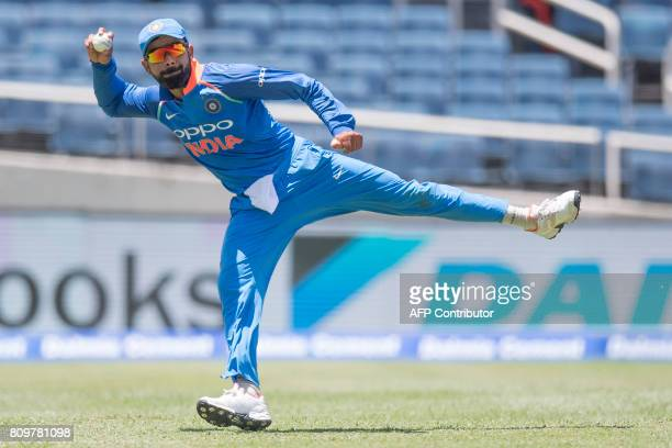 India's India's captain Virat Kohli throws the ball during the fifth One Day International match between West Indies and India at the Sabina Park...