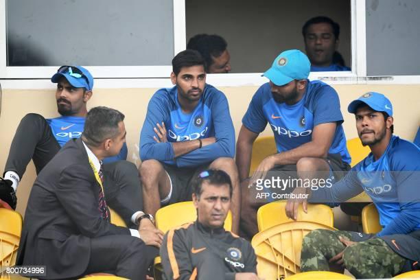 India's India's Ravindra Jadeja Bhuvneshwar Kumar India's Mohammed Shami and Umesh Yadav wait for the start of the second One Day International match...