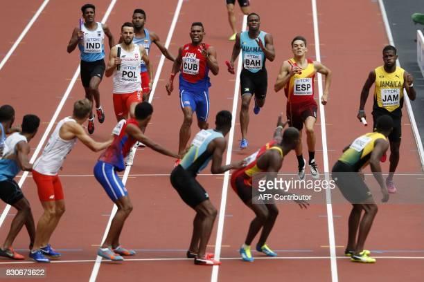 India's Jacob Amoj Poland's Lukasz Krawczuk Cuba's Adrian Chacon Bahamas' Michael Mathieu Spain's Lucas Bua and Jamaica's Steven Gayle run to hand...