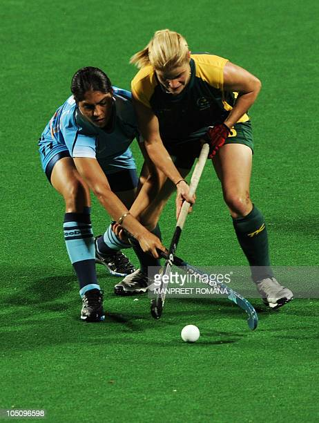 India's Jasjeet Kaur Handa fights for the ball with South Africa's Jennifer Wilson during their field hockey match at the Major Dhyan Chand National...