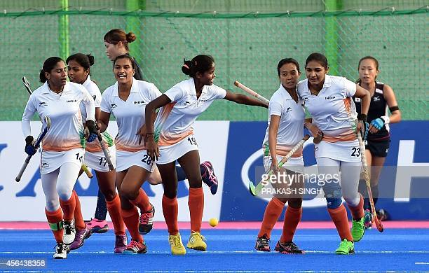India's Jaspreet Kaur celebrates a goal against Japan with teammates during their women's field hockey bronze medal match at the Seonhak Hockey...
