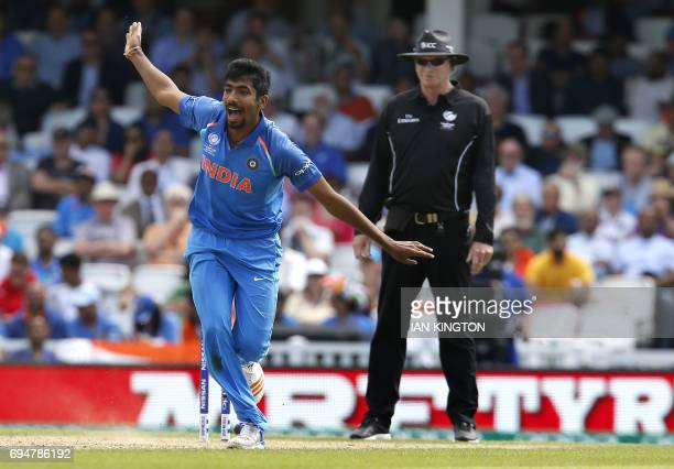 Indias Jasprit Bumrah appeals successfully for the wicket of South Africas Andile Phehlukwayo for 4 runs during the ICC Champions Trophy match...