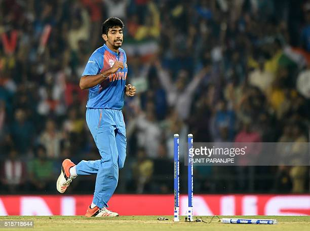 India's Jasprit Bumrah celebrates after taking the wicket of New Zealand batsman Corey Anderson during the World T20 cricket tournament match between...