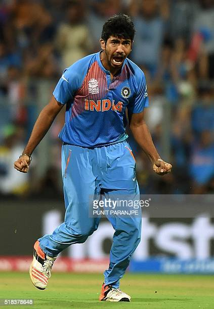 India's Jasprit Bumrah celebrates after taking the wicket of West Indies batsman Chris Gayle during the World T20 cricket tournament semifinal match...