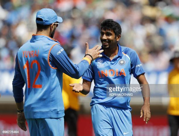 India's Jasprit Bumrah celebrates with India's Yuvraj Singh afte taking the wicket of Bangladesh's Mosaddek Hossain during the ICC Champions Trophy...