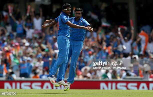 India's Jasprit Bumrah celebrates with Ravichandran Ashwin after running out Pakistan's Azhr Ali during the ICC Champions Trophy final at The Oval...