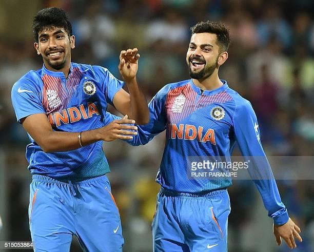 India's Jasprit Bumrah celebrates with teammate Virat Kohli after taking the wicket of South Africa's batsman Hashim Amla during the World T20 warmup...