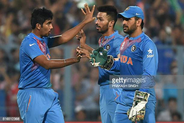 India's Jasprit Bumrah congratulates Hardik Pandya after he dismissed Pakistan's captain Shahid Afridi as India's captain Mahendra Singh Dhoni looks...