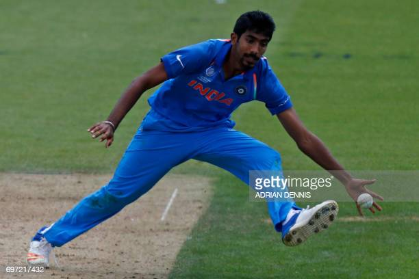 India's Jasprit Bumrah fields off his own bowling during the ICC Champions Trophy final cricket match between India and Pakistan at The Oval in...
