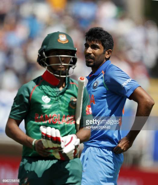 India's Jasprit Bumrah looks to the scoreboard after taking the wicket of Bangladesh's Mosaddek Hossain during the ICC Champions Trophy semifinal...