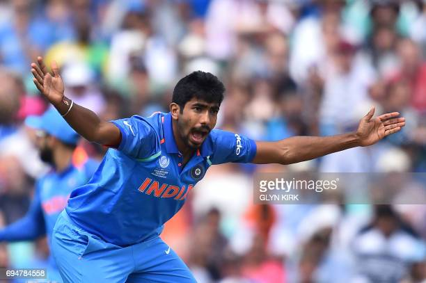 India's Jasprit Bumrah makes a successful appeal for the wicket of South Africa's Andile Phehlukwayo during the ICC Champions Trophy match between...