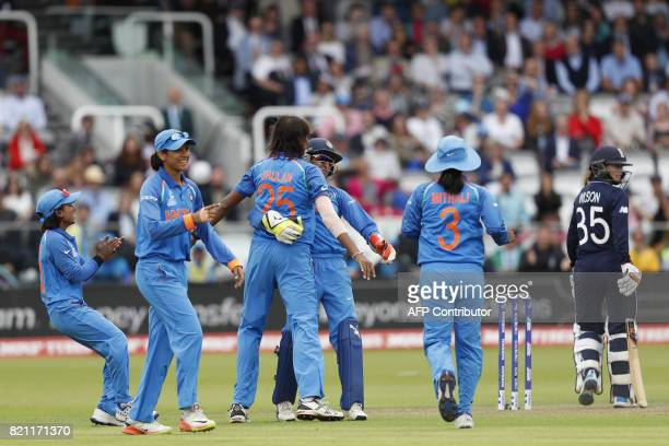 India's Jhulan Goswami celebrates with teammates after taking the wicket of England's Fran Wilson during the ICC Women's World Cup cricket final...