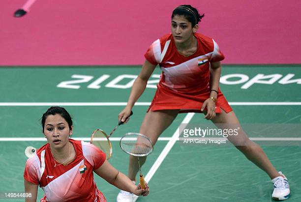 India's Jwala Gutta and Ashwini Ponnappa compete against Wen Hsing Cheng and Yu Chin Chien of Taiwan during their womens doubles badminton match at...