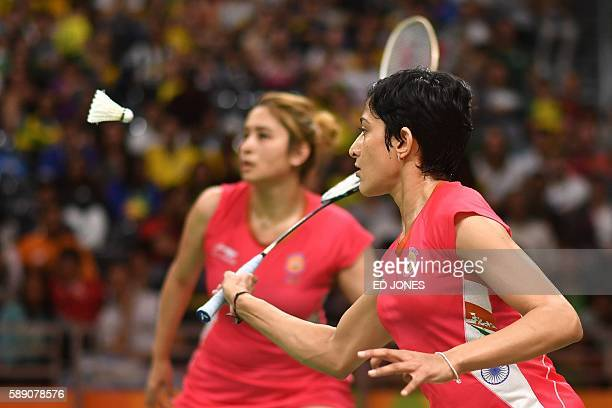 India's Jwala Gutta and India's Ashwini Ponnappa return to Thailand's Sapsiree Taerattanachai Thailand's Puttita Supajirakul during their women's...