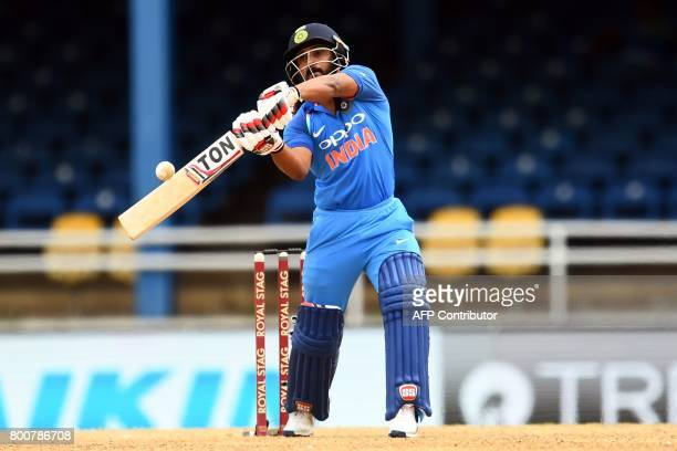 India's Kedar Jadhav plays a shot during the second One Day International match between West Indies and India at the Queen's Park Oval in Port of...